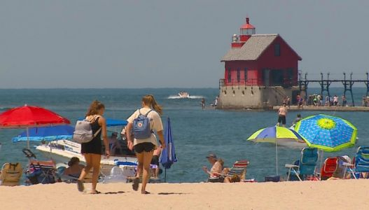 Folks visit beaches as health officials warn of virus risk