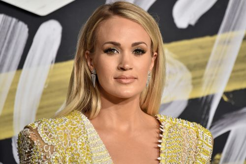 Carrie Underwood reveals she suffered three miscarriages
