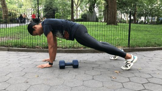 Improve Your Stability and Strengthen Your Abs With This Sculpting Dumbbell Exercise