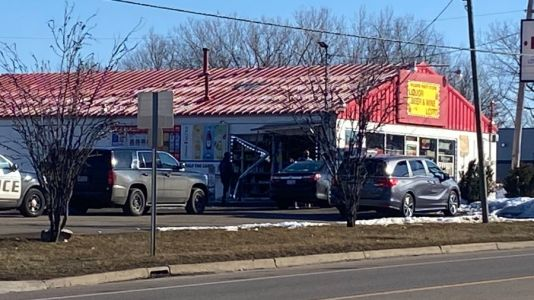 Police search for driver who crashed into Kzoo liquor store