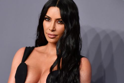 Kim Kardashian wears dress with barely-there top