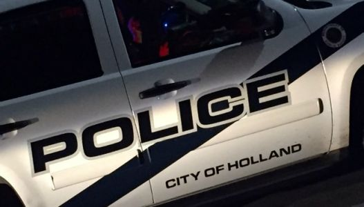 Police investigate drive-by shooting in Holland