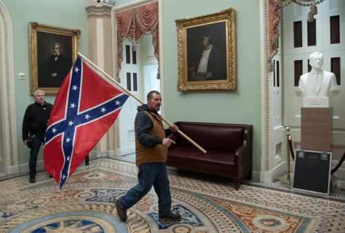 Man Who Carried Confederate Flag While Storming the Capitol Has Been Arrested