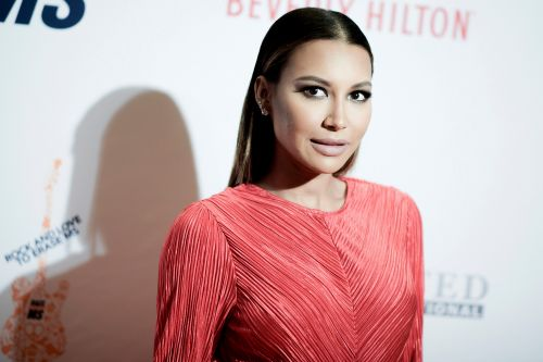 Naya Rivera's ex Ryan Dorsey, father swim lake as search continues for missing actress