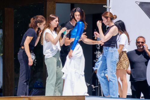 Kendall Jenner models wet suit and latex crop top in St. Tropez