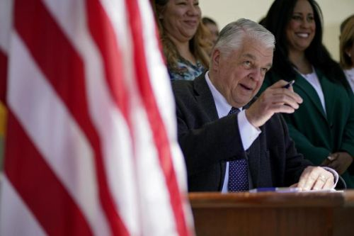 Governor signs law giving Nevada 1st presidential primary