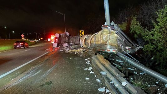 EB I-196 in GR closed due to overturned semi-truck; driver injured