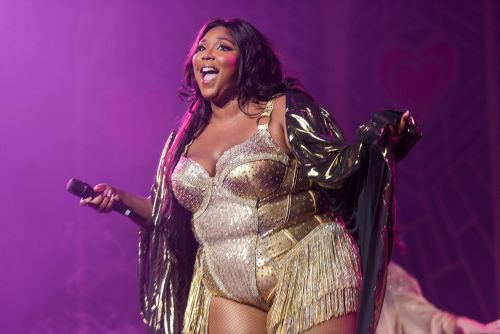 Lizzo shines in gold swimsuit after Jillian Michaels' body-shaming comments