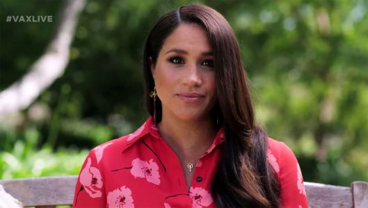 Meghan Markle wears 'woman power' necklace while showing off baby bump
